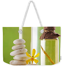 Weekender Tote Bag featuring the photograph Spa Oil Bottles by Atiketta Sangasaeng