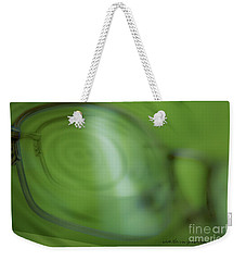Weekender Tote Bag featuring the photograph Spinner Vision by Vicki Ferrari Photography