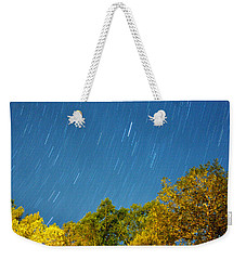 Star Trails On A Blue Sky Weekender Tote Bag by Kay Lovingood