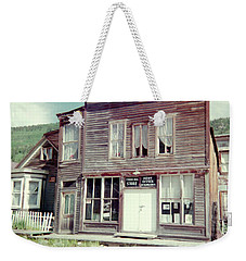 Weekender Tote Bag featuring the photograph Stark Bros Store by Bonfire Photography