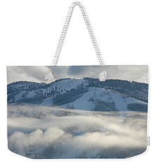 Weekender Tote Bag featuring the photograph Steamboat Ski Area In Clouds by Don Schwartz