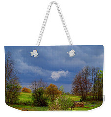 Weekender Tote Bag featuring the photograph Storm Cell by Kathryn Meyer