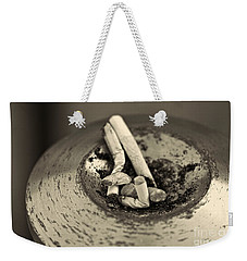 Weekender Tote Bag featuring the photograph Stubbed Out. by Clare Bambers