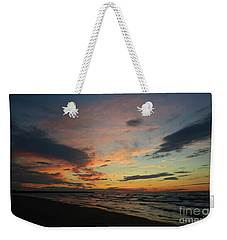 Weekender Tote Bag featuring the photograph Sundown  by Barbara McMahon