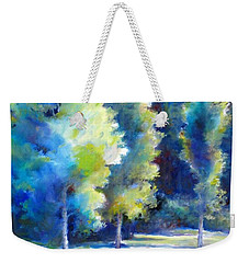 Weekender Tote Bag featuring the painting Sunlit Trees by Bonnie Goedecke