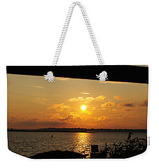 Weekender Tote Bag featuring the photograph Sunset Through The Rails by Michael Frank Jr