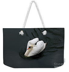 Weekender Tote Bag featuring the photograph Swan On Black Water by Les Palenik