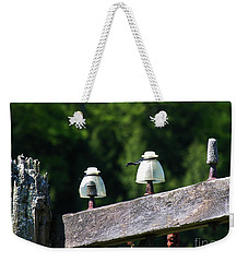 Weekender Tote Bag featuring the photograph Telephone Pole And Insulators by Sherman Perry