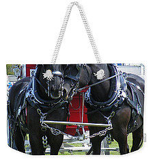 Weekender Tote Bag featuring the photograph Tender Moment by Davandra Cribbie