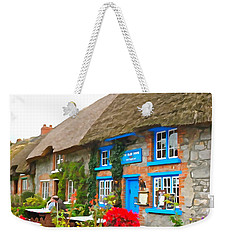 Weekender Tote Bag featuring the photograph The Blue Door by Charlie and Norma Brock