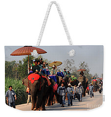 Weekender Tote Bag featuring the photograph The Elephant Parade by Vivian Christopher