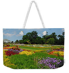Weekender Tote Bag featuring the photograph The Gardens Of The Conservatory by Lynn Bauer
