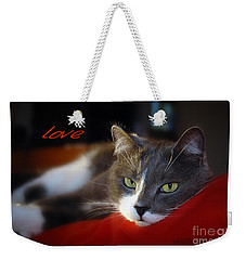 Weekender Tote Bag featuring the photograph The Look Of Love by Vicki Ferrari