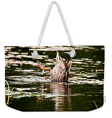 Weekender Tote Bag featuring the photograph The Meaning Of Duck by Brent L Ander