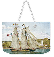 Weekender Tote Bag featuring the photograph The Pride Of Baltimore In Halifax by Verena Matthew