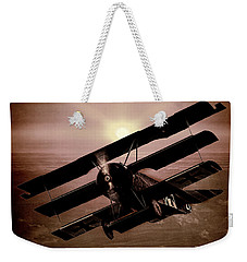 Weekender Tote Bag featuring the photograph The Red Baron's Fokker At Sunset by Chris Lord