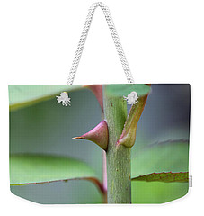 Weekender Tote Bag featuring the photograph Thorny Stem by Todd Blanchard