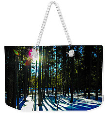 Weekender Tote Bag featuring the photograph Through The Trees by Shannon Harrington