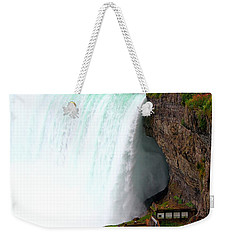 Weekender Tote Bag featuring the photograph Thundering Force by Davandra Cribbie
