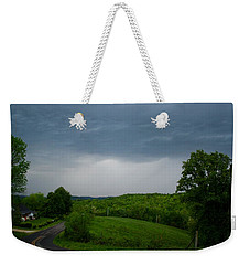 Weekender Tote Bag featuring the photograph Thunderstorm by Kathryn Meyer