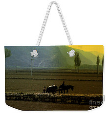 Weekender Tote Bag featuring the photograph 'til The Day Is Done by Lydia Holly