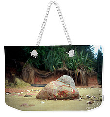 Weekender Tote Bag featuring the photograph Tinopai Beach Rock by Mark Dodd