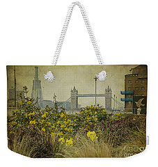 Weekender Tote Bag featuring the photograph Tower Bridge In Springtime. by Clare Bambers