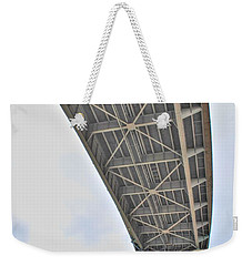 Weekender Tote Bag featuring the photograph Under The Skyway by Michael Frank Jr