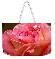 Weekender Tote Bag featuring the photograph Unfolding by Rory Sagner