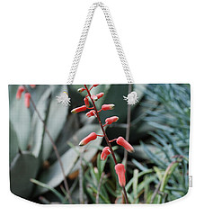 Weekender Tote Bag featuring the photograph Unique Flower by Jennifer Ancker