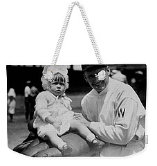 Weekender Tote Bag featuring the photograph Walter Johnson Holding A Baby - C 1924 by International  Images