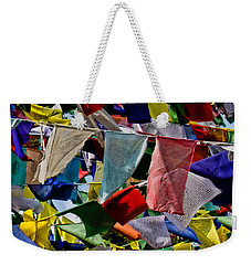 Weekender Tote Bag featuring the photograph Waving Prayer Flags by Don Schwartz