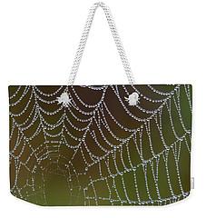 Weekender Tote Bag featuring the photograph Web With Dew by Daniel Reed