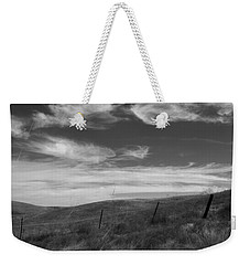 Weekender Tote Bag featuring the photograph Whipping Up The Hillside by Kathleen Grace