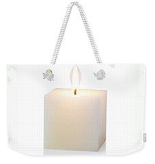 Weekender Tote Bag featuring the photograph White Cubic Candle by Atiketta Sangasaeng