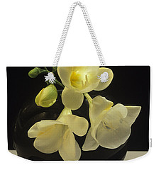 Weekender Tote Bag featuring the photograph White Freesias In Black Vase by Susan Rovira