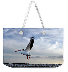 Weekender Tote Bag featuring the photograph White Pelican Flying Over Island by Dan Friend