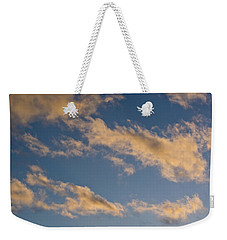 Weekender Tote Bag featuring the photograph Wind Driven Clouds by Mick Anderson