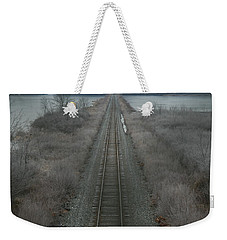 Weekender Tote Bag featuring the photograph Winter Tracks  by Neal Eslinger