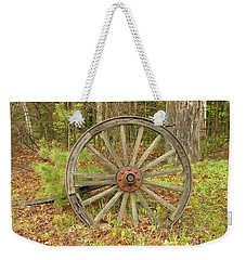 Weekender Tote Bag featuring the photograph Wood Spoked Wheel by Sherman Perry