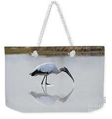 Weekender Tote Bag featuring the photograph Wood Stork Eating by Dan Friend