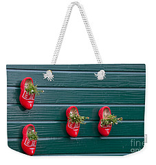 Weekender Tote Bag featuring the digital art Wooden Shoes On Teh Wall by Carol Ailles