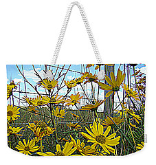 Weekender Tote Bag featuring the photograph Yellow Flowers By The Roadside by Alice Gipson