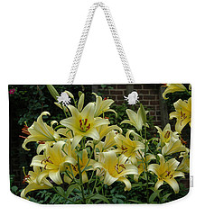 Weekender Tote Bag featuring the photograph Yellow Oriental Stargazer Lilies by Tom Wurl