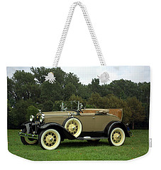 Weekender Tote Bag featuring the photograph 1931 Ford Model A Roadster by Tim McCullough