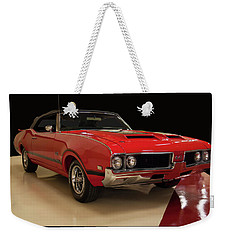 Weekender Tote Bag featuring the photograph 1969 Oldsmobile 442 W 30 by Chris Flees