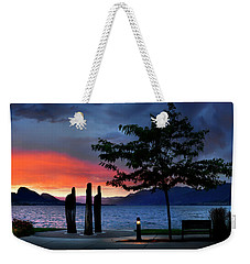 Weekender Tote Bag featuring the photograph A Sunset Story by John Poon