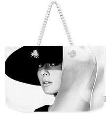Weekender Tote Bag featuring the photograph Audrey Hepburn As Holly Golightly by R Muirhead Art