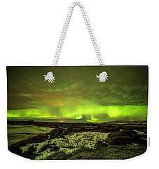 Aurora Borealis Over A Frozen Lake Weekender Tote Bag