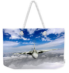Weekender Tote Bag featuring the digital art Avro Vulcan Head On Above Clouds by Gary Eason
